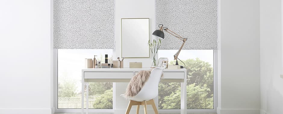 On trend black and white patterned roller blinds