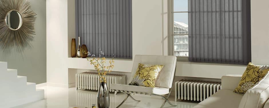 Grey vertical blinds in retro living room