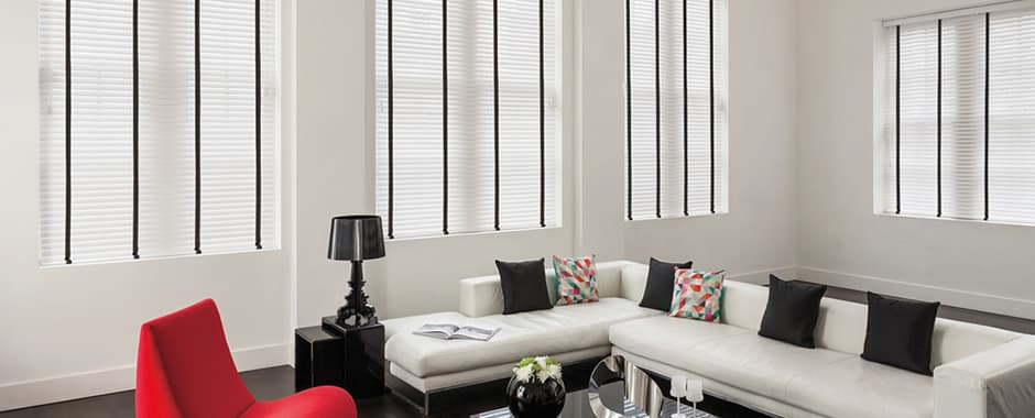 White faux wood blinds with black tapes in living room